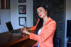 Pretty woman working on laptop at home. Royalty Free Stock Images