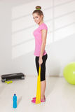 Pretty woman workout with elastic band Stock Image