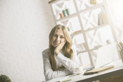 Pretty woman at workplace Stock Image
