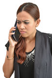 Pretty woman worried by mobile phone Stock Photography