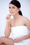 Pretty Woman Wrapped in White Towel on Body Stock Image
