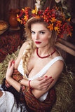 Pretty woman with wreath of red leaves in rustic style Stock Images