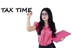 Pretty woman writes tax time Stock Photography