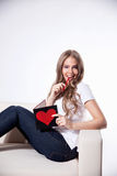 Pretty woman writing a love card Royalty Free Stock Image