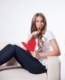 Pretty woman writing a love card Stock Photos