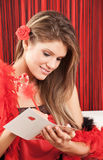 Pretty woman writing something on a card Royalty Free Stock Images