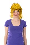 Pretty woman with yellow carnival wig Stock Photography
