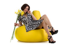 Pretty woman with yellow day-lily Royalty Free Stock Photo