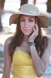 Pretty woman in a yellow dress Royalty Free Stock Images