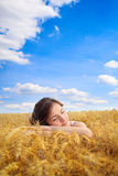 Pretty woman on yellow wheat field Royalty Free Stock Photography