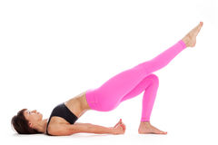 Pretty Woman in Yoga Pose - Bridge Pose Position. Royalty Free Stock Photo