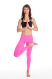 Pretty Woman in Yoga Pose - Half Lotus Tree Position. Royalty Free Stock Image