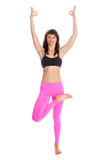 Pretty Woman in Yoga Pose - Half Lotus Tree Position. Pretty woman doing yoga in half lotus tree pose yoga. Isolated on white studio background Royalty Free Stock Images