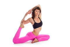 Pretty Woman in Yoga Pose - One Legged KIng Position. Royalty Free Stock Images