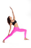 Pretty Woman in Yoga Pose - Reverse Warrior Position. Pretty woman in reverse warrior yoga pose. Isolated on white studio background Stock Images