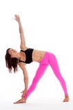 Pretty Woman in Yoga Pose - Triangle Position. Royalty Free Stock Photos