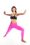 Pretty Woman in Yoga Pose - Warrior Position. Royalty Free Stock Image
