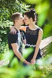 Pretty woman and young man tender kiss Stock Photos