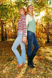 Pretty womans in the autumn park. Royalty Free Stock Photo