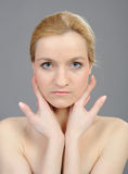 Pretty womans face with pure healthy skin Stock Image