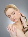 Pretty womans face with pure healthy skin Stock Photography