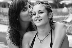 Pretty women. Portrait of two pretty women at the pool Royalty Free Stock Images