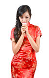 Pretty women with Chinese traditional dress Cheongsam and drinki Royalty Free Stock Photo