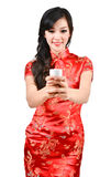 Pretty women with Chinese traditional dress Cheongsam and drinki Royalty Free Stock Images