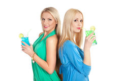 Pretty women with cocktails. Picture of two happy young women with cocktails Royalty Free Stock Photos