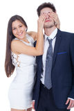 Woman covering mans eyes Royalty Free Stock Photography