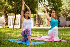 Pretty women doing yoga Royalty Free Stock Images