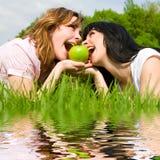Pretty women eating green apple Stock Image