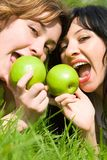 Pretty women eating green apples Royalty Free Stock Photos