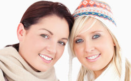 Pretty women with heads together Stock Images