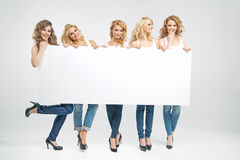 Pretty women holding empty board royalty free stock photo