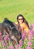 Pretty women with  horse in field Royalty Free Stock Photography