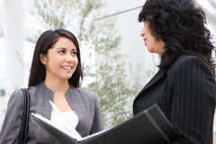 Pretty Women at Office Building Stock Photos