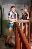 Pretty women in old house Royalty Free Stock Photos