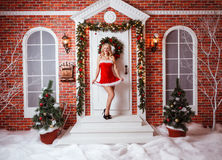 Pretty women outdoor in red clothes of santa. Wonderful portrait of the beauty in red xmas clothes Stock Images