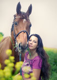 Pretty women with own horse Stock Image