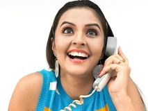 Pretty women on phone. A pretty asian woman of indian origin speaking in the phone Royalty Free Stock Images
