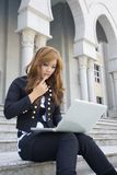 Pretty women play laptop Stock Images