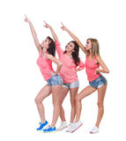 Pretty women posing in sexy jeans shorts. Isolated Royalty Free Stock Images