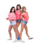 Pretty women posing in sexy jeans shorts. Isolated Stock Images