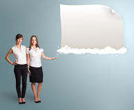 Pretty women presenting modern copy space on clouds Stock Photo