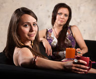 Pretty Women Relaxing on Sofa Royalty Free Stock Photo
