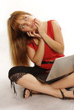 Pretty women relaxing and using laptop computer Stock Photography