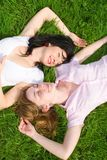 Pretty women rest on the grass Royalty Free Stock Image