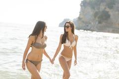 Pretty women in the sea at summer. Two pretty women in the sea at summer royalty free stock photo