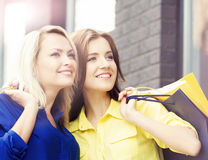 Pretty women with shopping bags outdoors Royalty Free Stock Image
